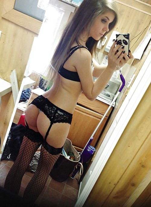 hot brunette selfie camera phone pic in black lingerie with fishnet nylons and garters